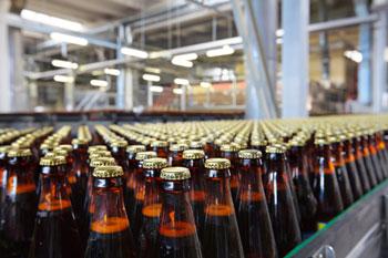 Beer-bottles-on-conveyor-shutterstock_171892424-350x-72