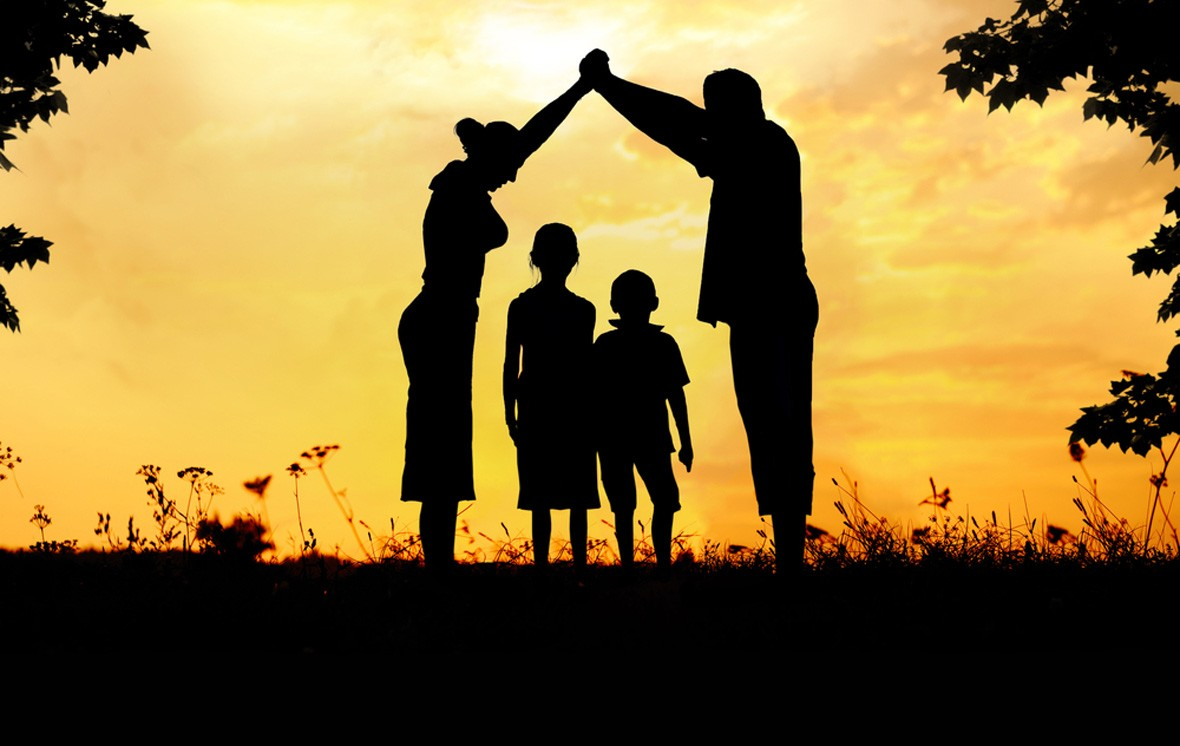 silhouette of family at sunset