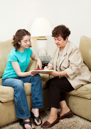 Girl-signing-documents-with-mother-300x
