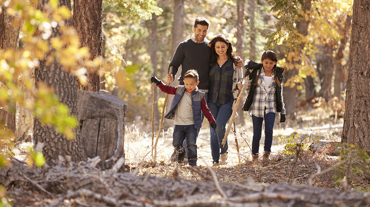 Young family on hike through woods