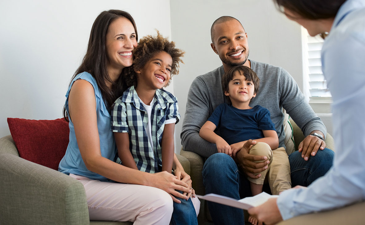 Young family meeting with tax attorney