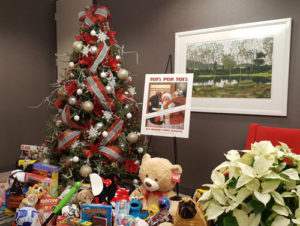 Lommen Abdo's tree and toys for Toys for Tots drive.