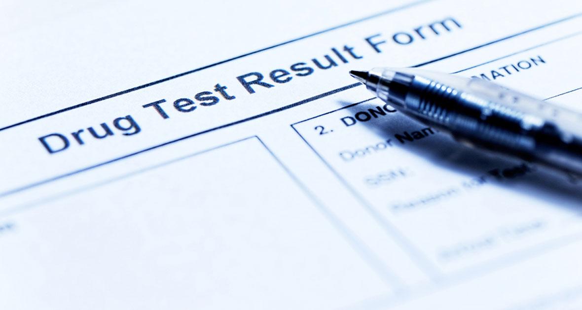 Paper Drug Test Result form with pen