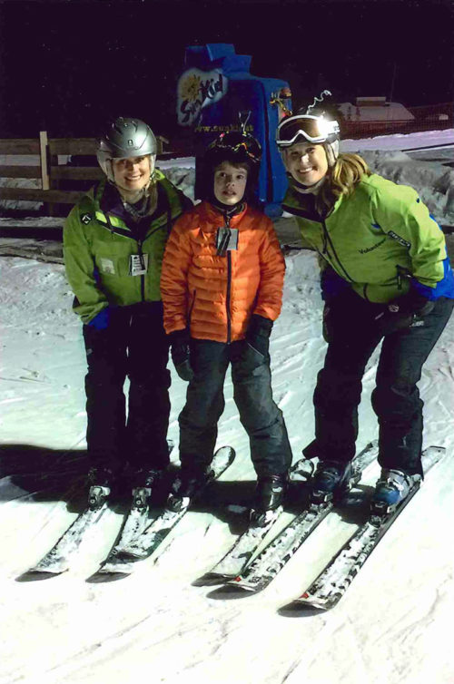 Lauren Nuffort, right, volunteering with the Courage Kenny Rehabilitation Institute teaching adaptive alpine skiing at Hyland Hills Ski Area in Bloomington, Minnesota.