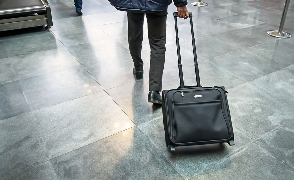Traveler with suitcase in airport