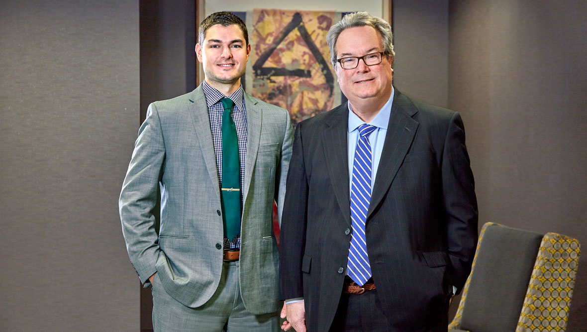 Brent Tunis and Larry Rocheford, Attorneys with Lommen Abdo Law Firm